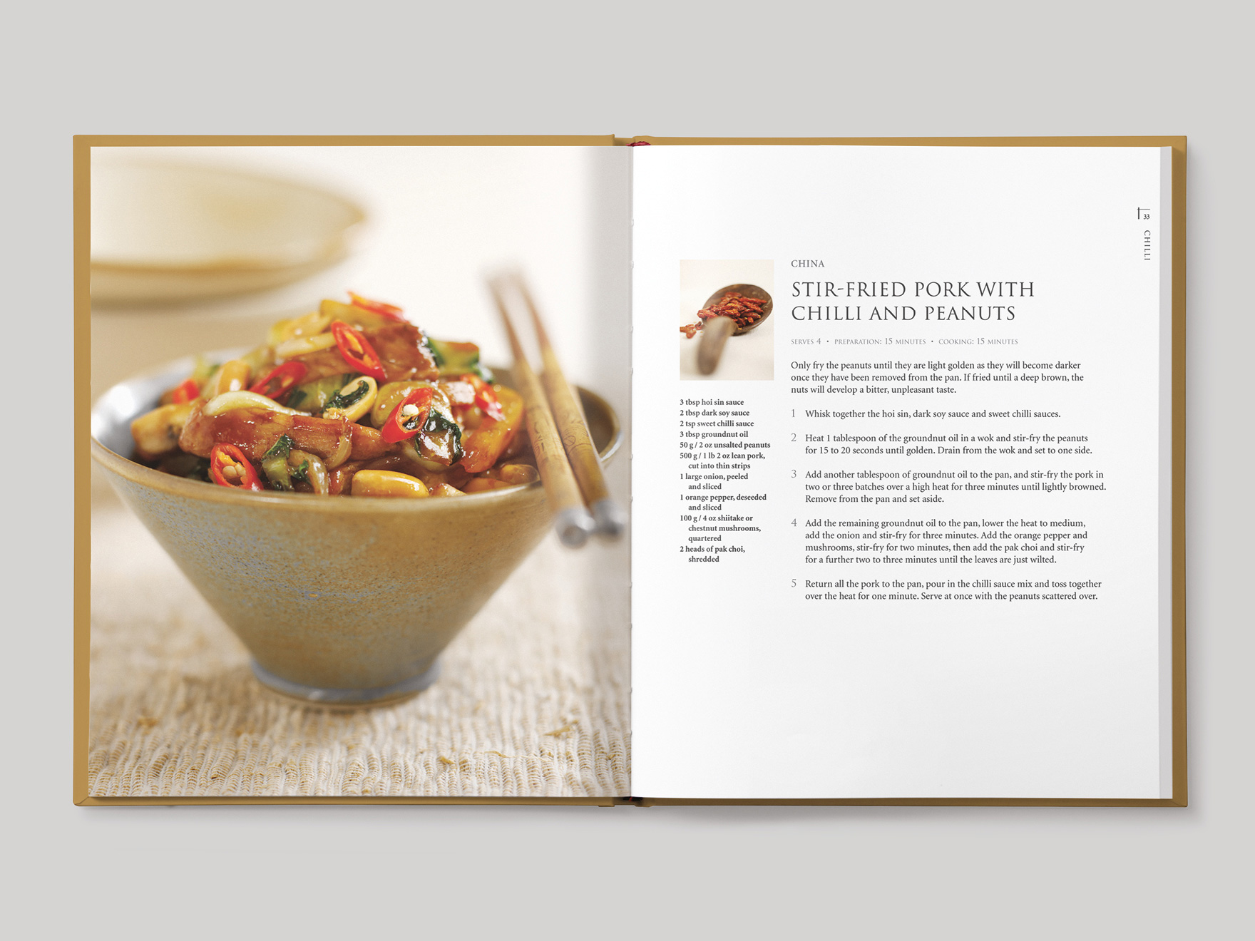 Inside book pages from Asian Flavours showing a recipe for stir-fried pork with chilli and peanuts