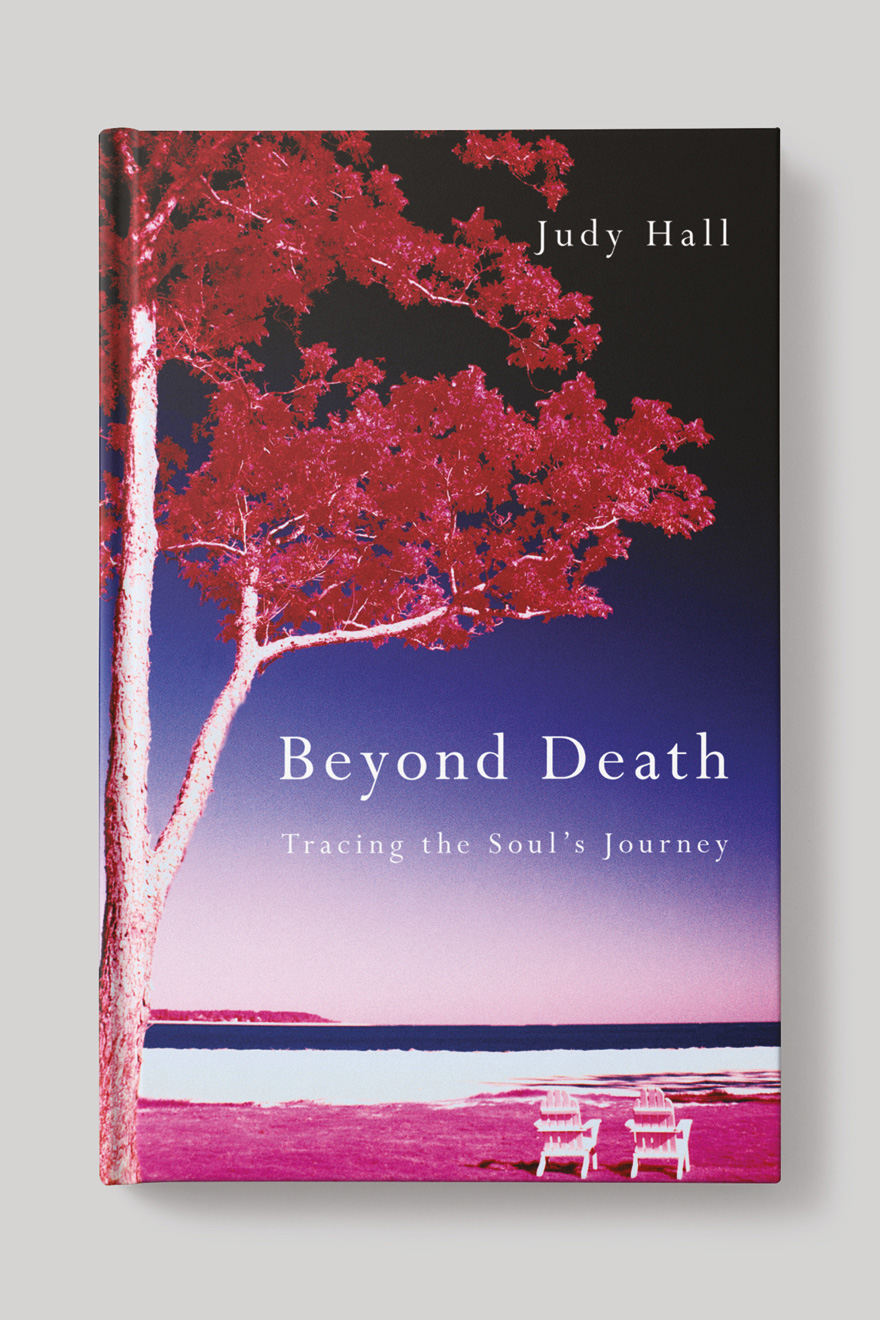 Front book cover to Beyond Death, showing a tree on a deserted beach with two empy deck chairs looking out upon the horizon
