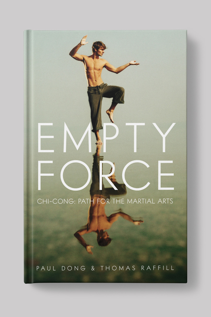 Front of the book cover for Empty Force, a martial arts book. Cover shows an image of a young man standing in Tai Chi pose on a beach, his image is reflected in the water beneath him.