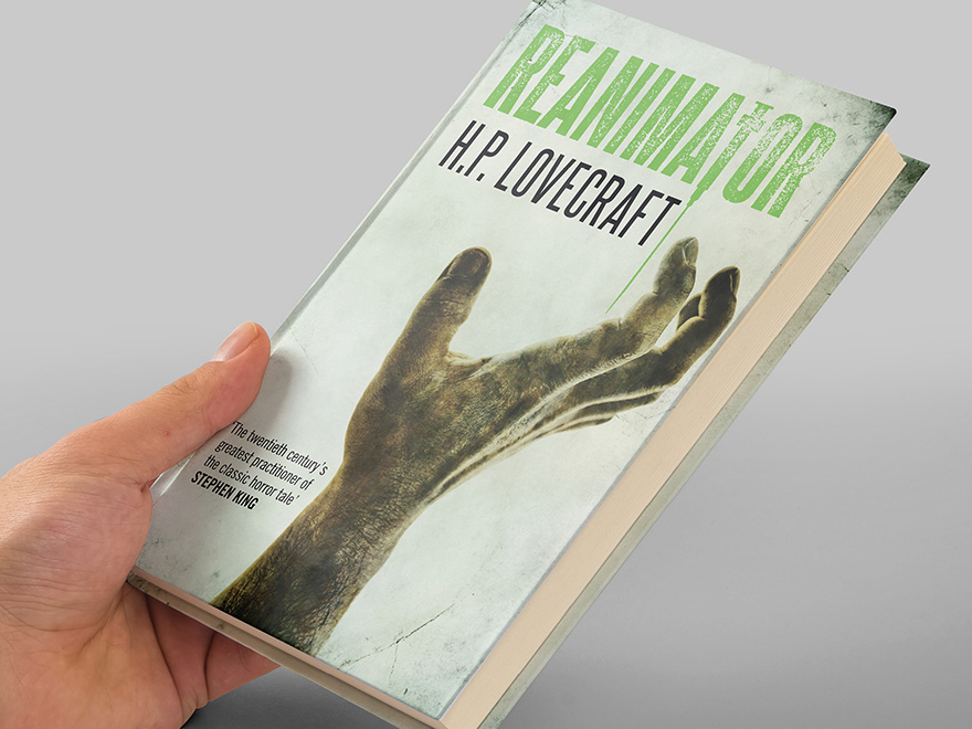 A hand holding a copy of the Hesperus Press edition of H.P. Lovecraft's Reanimator novel with the front cover designed by Roland Codd